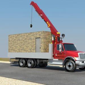 Los camiones grúa acercan los contenedores y la placa blindada al lugar de instalación