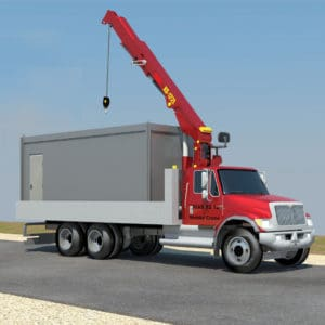 Camión grúa que acerca el contenedor al sitio de instalación