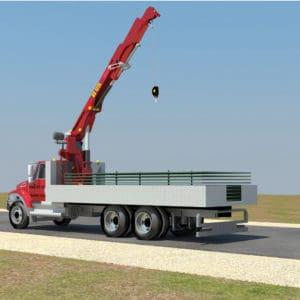 Camión grúa que acerca las paredes protectoras de acero al sitio de instalación